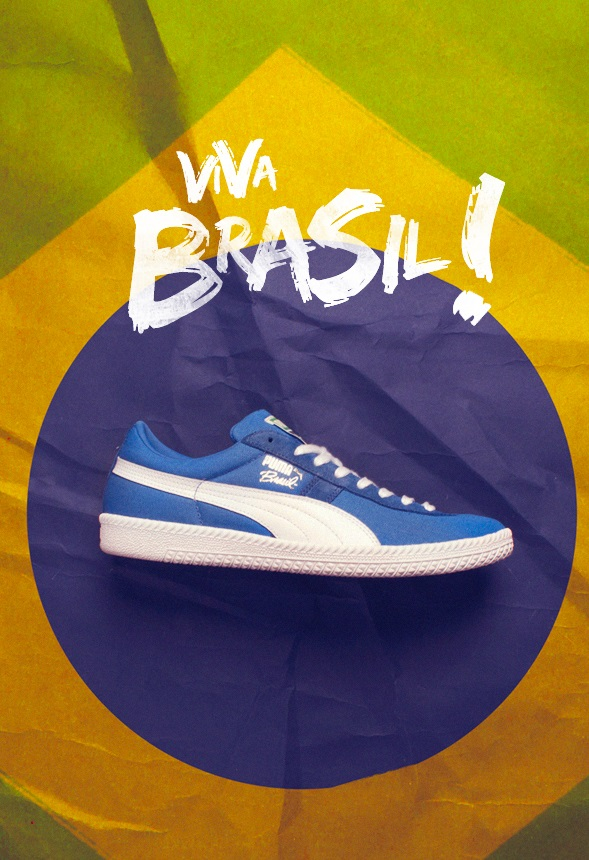 blue puma brasil trainers with a brazil flag behind it