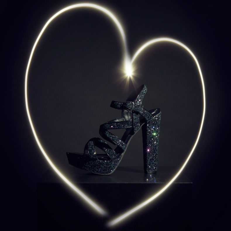 womens black glitter high heel with a heart around it