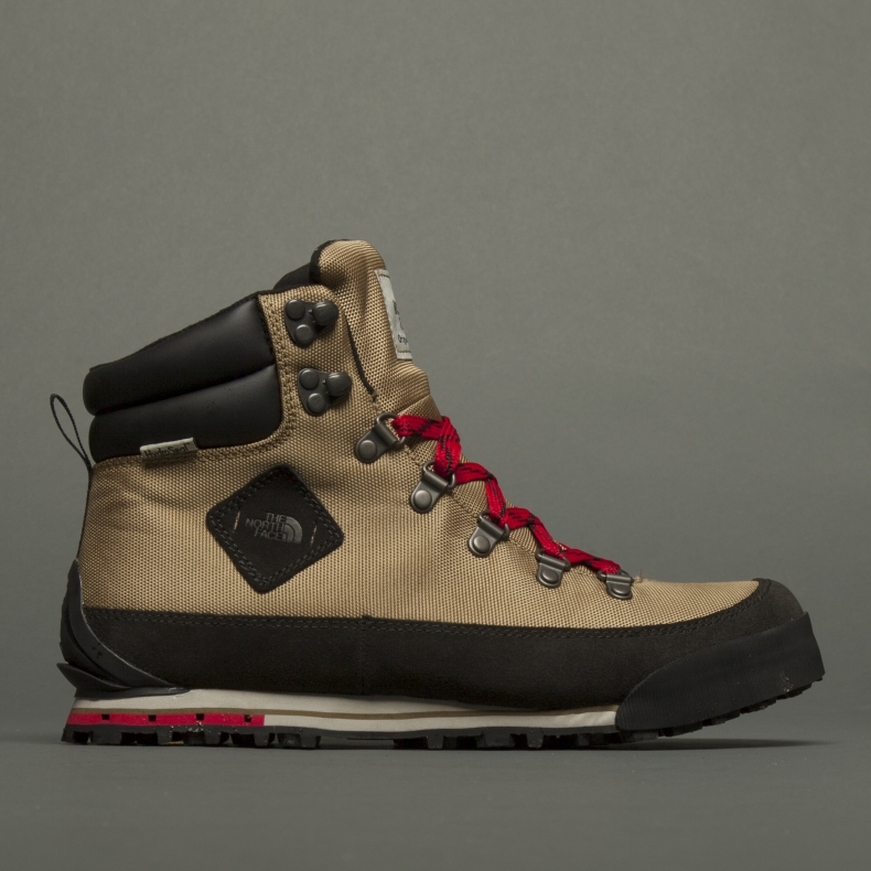 Beige and red North Face boots