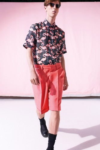 model at Marc Jacobs Spring 2015 Menswear show wearing flamingo shirt in pink and black and pink tailored trousers