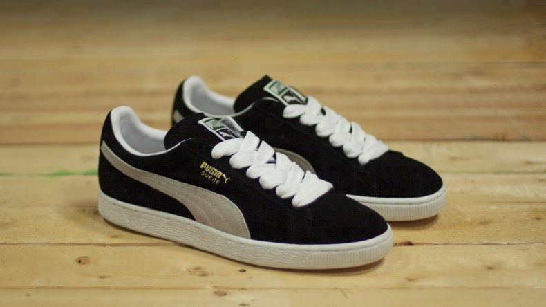 ... mens puma suede classic eco trainers in black and white with gold  brandiing .