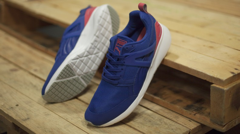 mens PUMA Aril Evolution trainers in man made blue with lisht pink Formstrip and white rubber sole unit