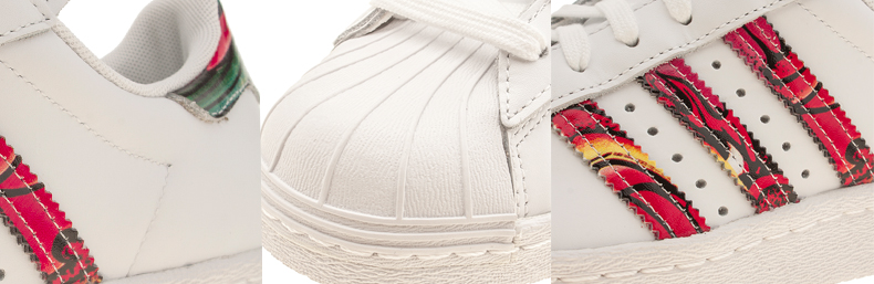 womens white leather adidas Superstar Rita Ora Dragon trainers with multi-coloured print