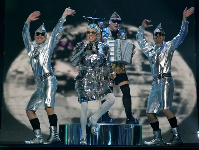 Verka Serduchka singing and performing Dancing Lasha Tumbai at eurovision 2007 in silver glittery costumes