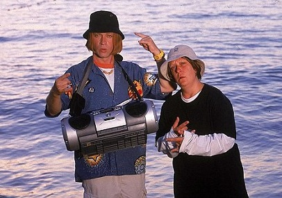 image from kev and perry go large movie with them in the sea wearing bucket hats and a boombox around kevs neck