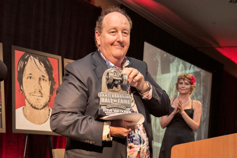 steve van doren from Vans holding his icon award from the skateboarding hall of fame in may 2015