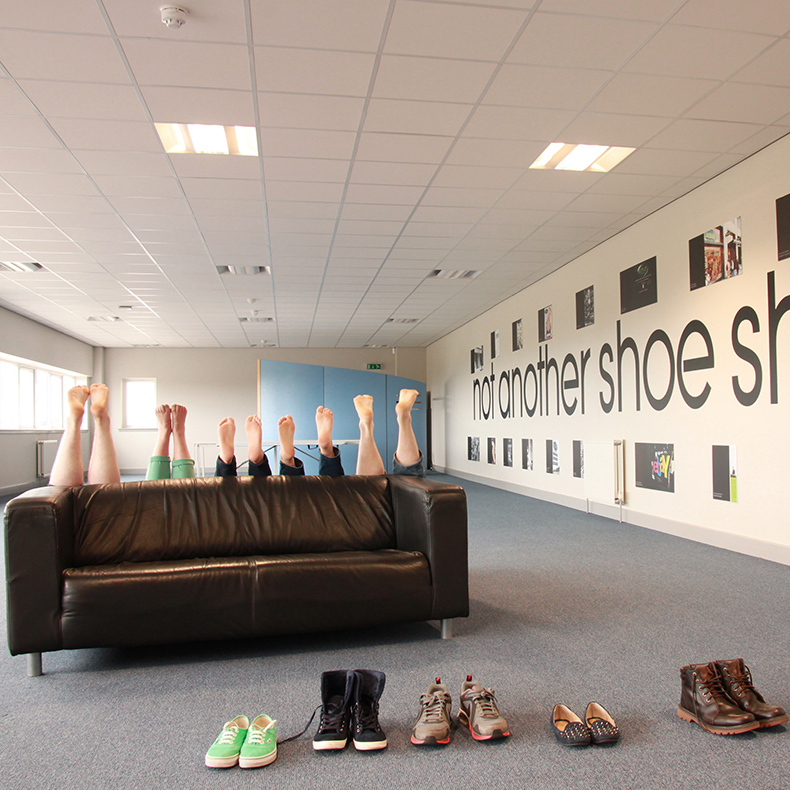 toms one day without shoes 2015 initiative with schuh head office staff in bare feet behind sofa with shoes on floor
