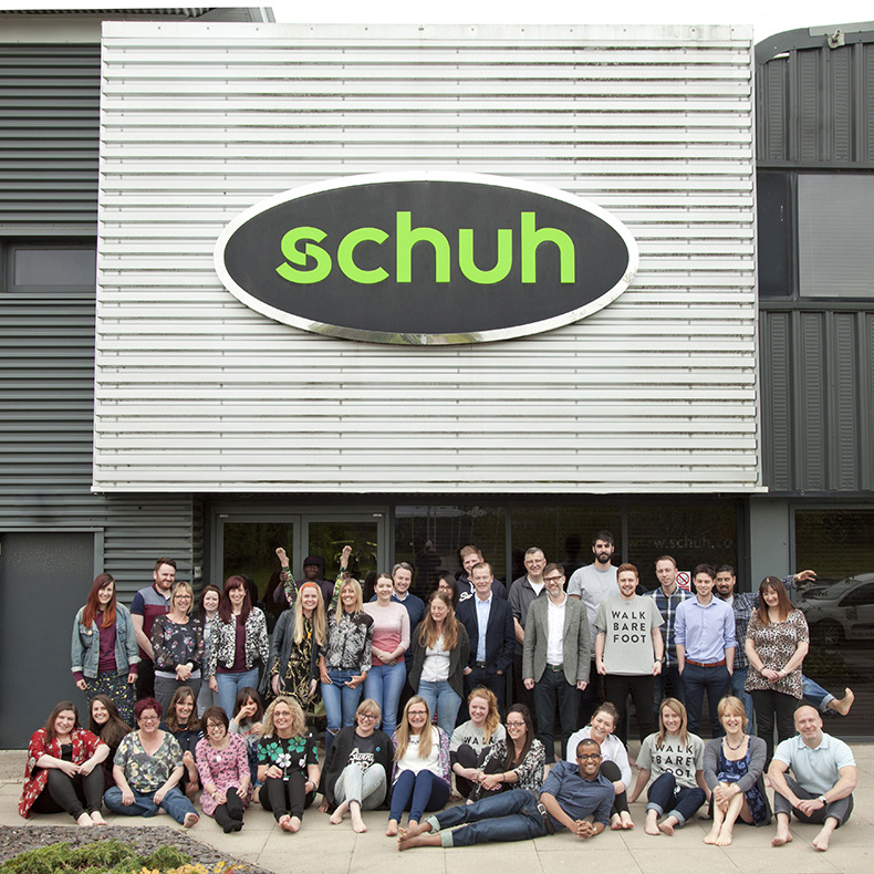toms one day without shoes initiative 2015 image of schuh head office staff outside with bare feet