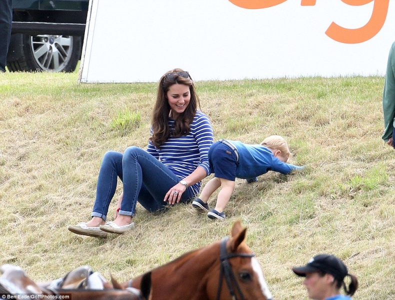 kate middleton and prince george play on grassy hill in his navy crods and navy outfit