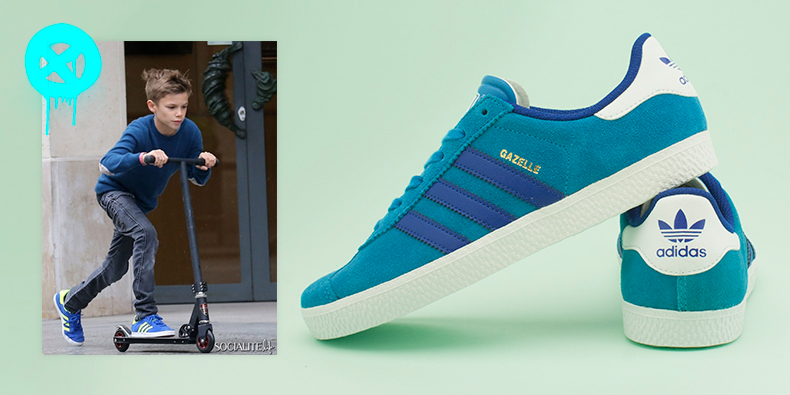 kids boys adidas gazelle 2 trainers in blue suede next to Romeo Beckham wearing adidas riding a scooter in Paris