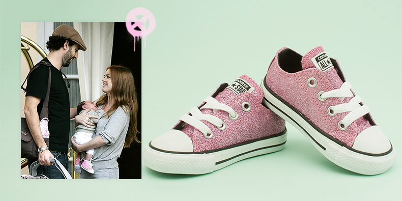 kids girls toddler Converse trainers in pink glitter next to baby olive being held by Isla Fisher