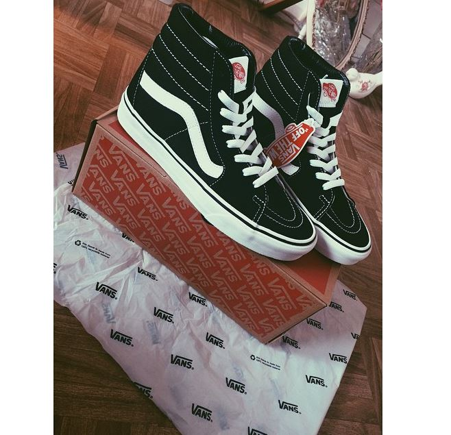 black and white Vans Sk8 Hi trainers