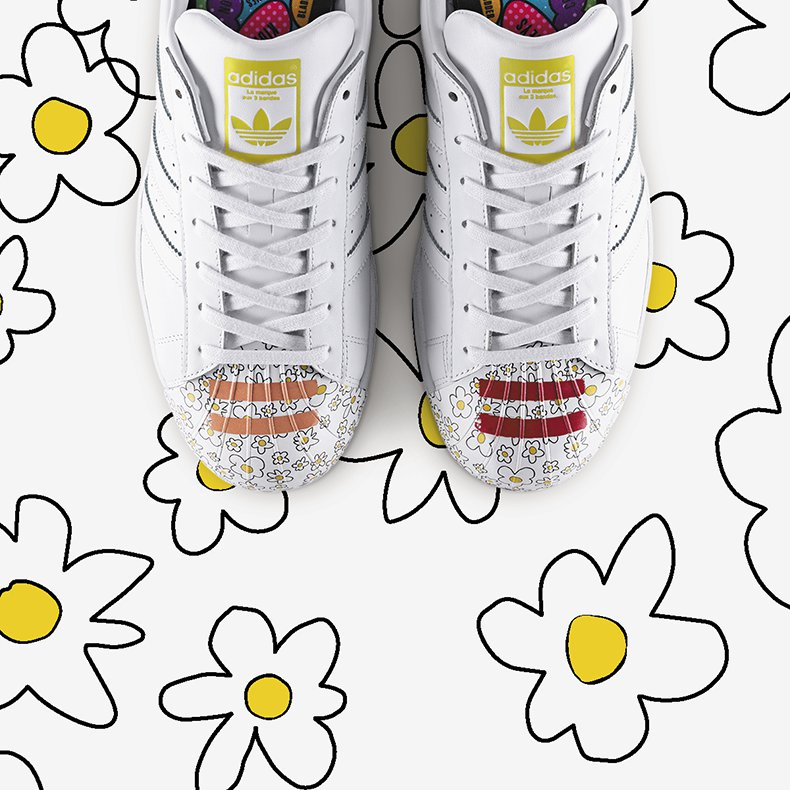 white pharrell superstar supershell trainers for men with floral illustration on the toe cap