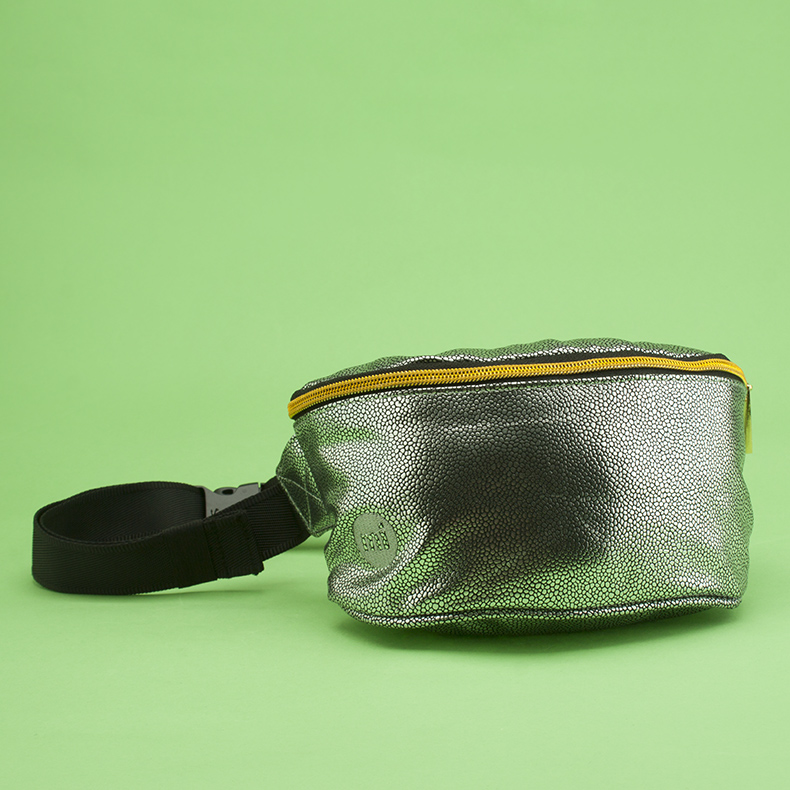 silver man-made bum bag from Mi Pac with gold zip on green background at schuh