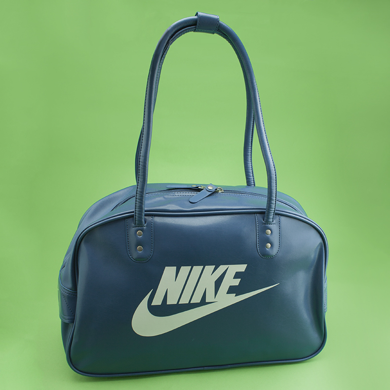 blue and white man-made Heritage SI Shoulder bag from Nike on green background at schuh
