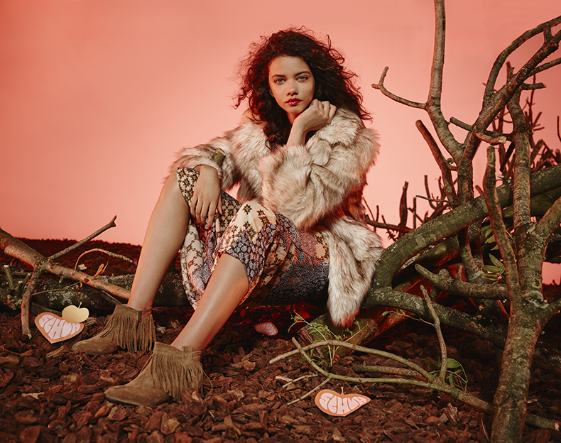 schuh aw15 campaign fashion shoot with female model in fur jacket and suede fringe boots