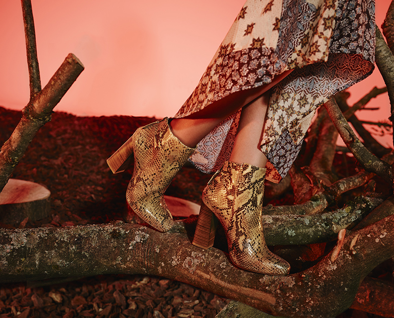 schuh aw15 campaign fashion shoot with female model in schuh turn around snakeskin boots