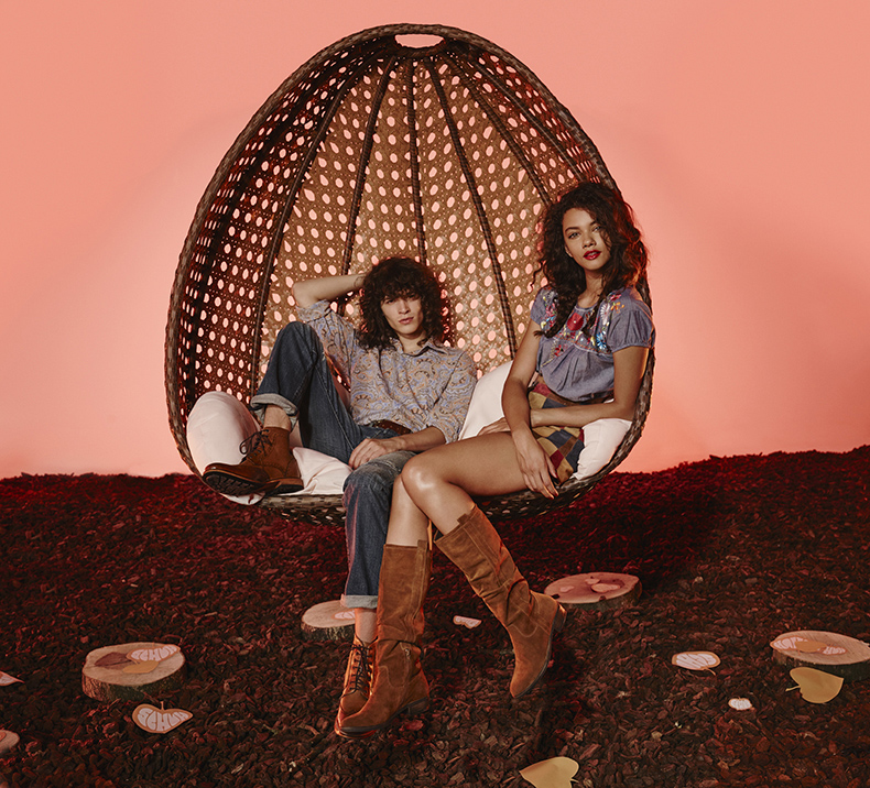 schuh aw15 campaign fashion shoot with male and female model in 70s slouch boots