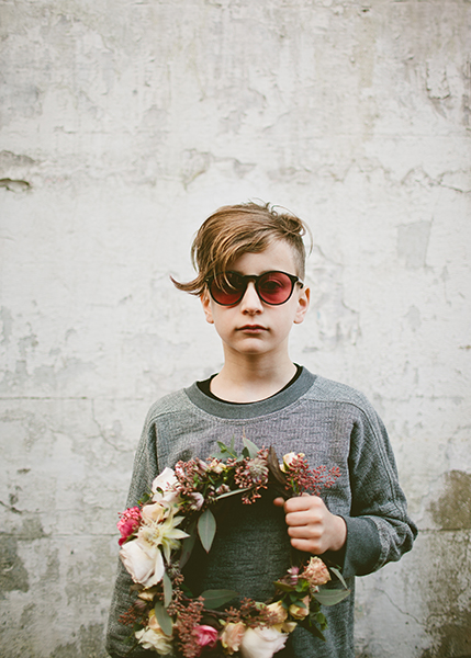 young-soles-kids-shoe-brand-at-schuh-little-boy-model-with-sunglasses-holding-flowers