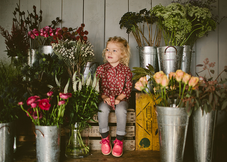 young-soles-little-girl-wearing-brando-brogue-shoes-in-pink-leather-sitting-with-flowers