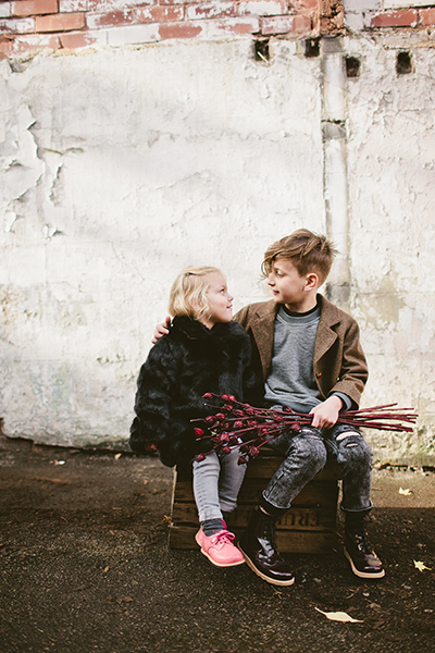 young-soles-little-girl-and-boy-wearing-brogue-shoes-and-boots-holding-flowers