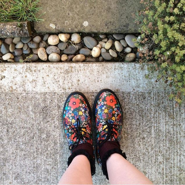 women wearing dr martens 1461 3 eye shoes in multicoloured floral print