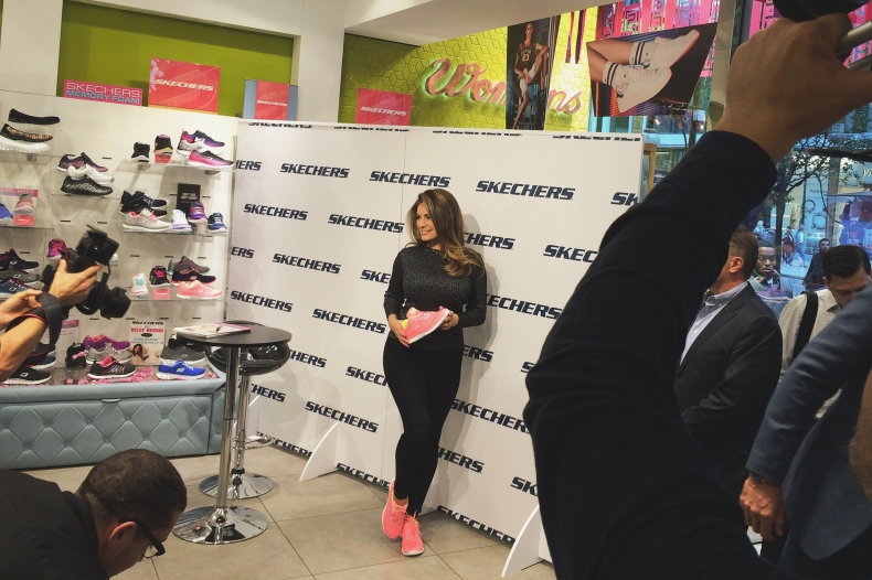 kelly brook holding pink fabric skechers flex appeal obvious choice trainers with yellow accents at schuh London Marble Arch store