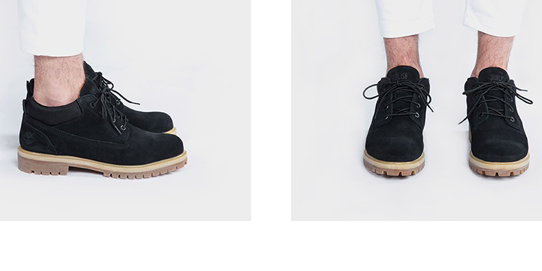 publish and timberland collaboration featuring male model with white tapered trousers and classic ox boots in black suede