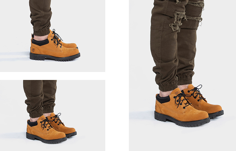 publish and timberland collaboration featuring model wearing mens classic ox boots in wheat nubuck with khaki tapered denim joggers