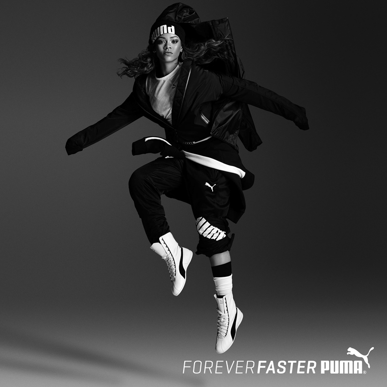 rihanna wearing black and white leather PUMA Eskiva boxing shoes and jumping in air