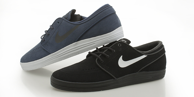 nike skateboarding navy and white and black and white trainers