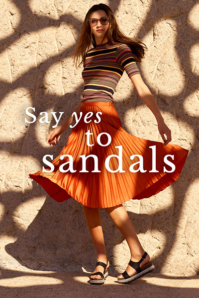womens sandals at schuh including black leather with orange pleated skirt