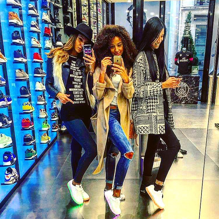 wize and ope trainers worn by three girls taking mirror selfie