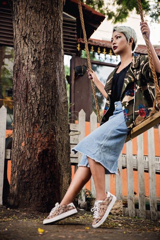 snakeskin sneakers work with raw denim skirt and camo printed bomber schuh blog