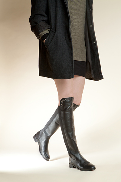 womens black over the knee boots with khaki jumper and wool coat on schuh blog