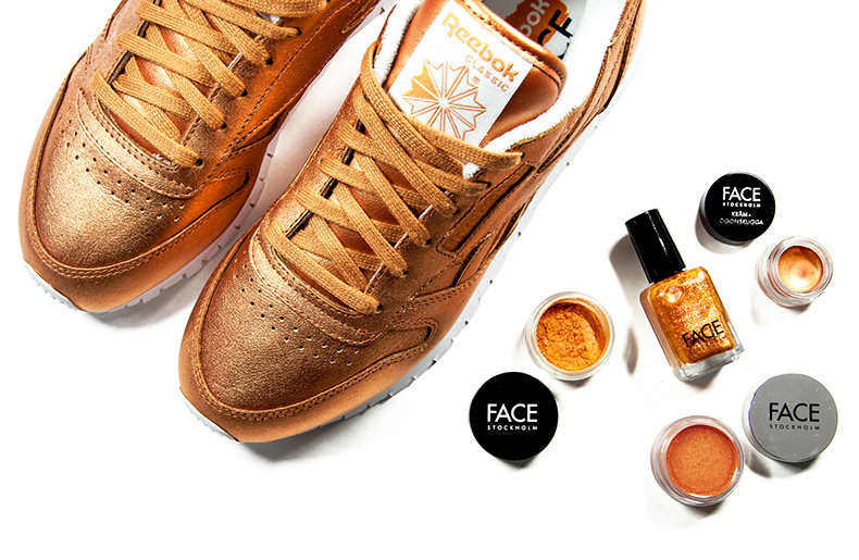 womens Reebok Classic Leather trainers in bronze with FACE Stockholm cosmetics