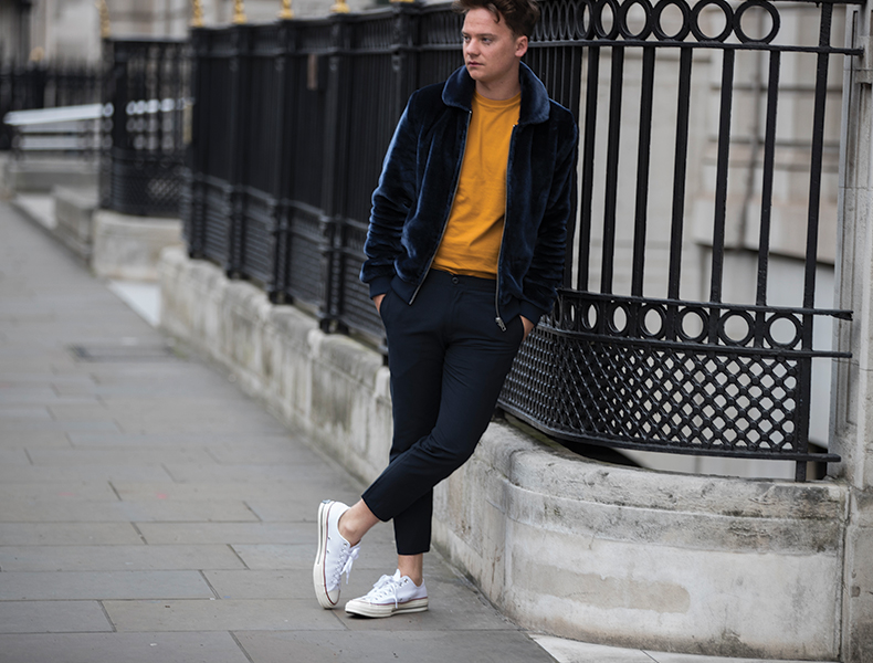 Conor Maynard wearing white fabric Converse All Star Lo trainers at LFWM schuh blog