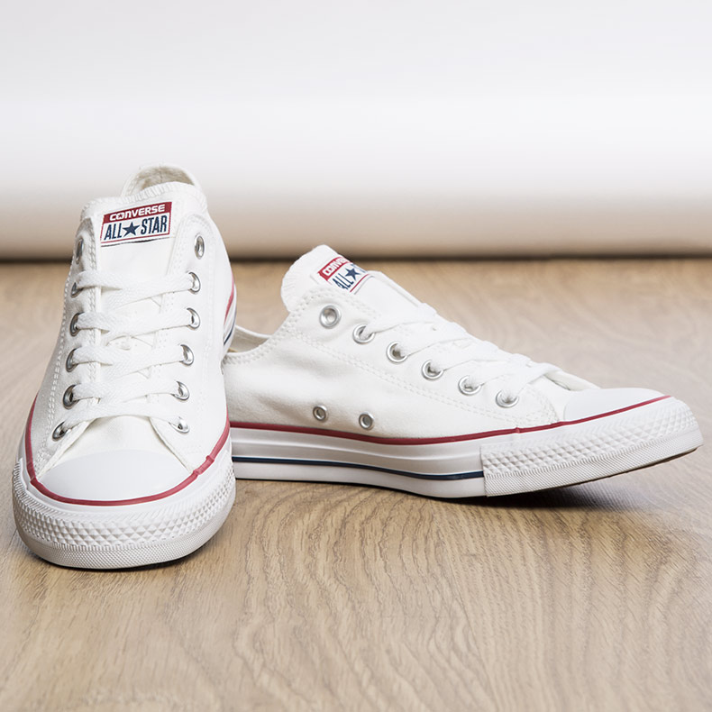 womens and mens Converse Chuck Taylor All Star Lo Trainers in white canvas with red and navy striped soles