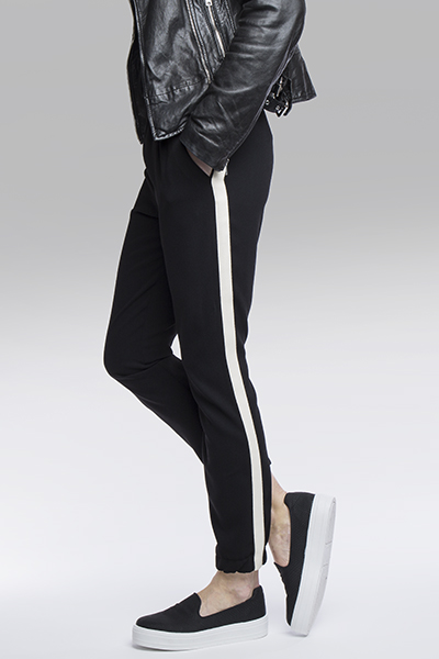womens slip on flatform shoes in black and white worn with track pants and leather jacket on schuh blog